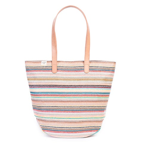 """<p><strong><em>$80, </em></strong><strong><em><a href=""""http://shop.herschelsupply.com/products/auden-tote-womens-daybreak"""" target=""""_blank"""">herschelsupply.com</a></em></strong></p><p>The Auden tote is perfect for everyday use. Its colorful woven finish is easy to match, and the spacious interior has tons of room for all your necessities. Vegetable-tanned leather handles are designed with extra length so it fits comfortable on your shoulder.</p>"""