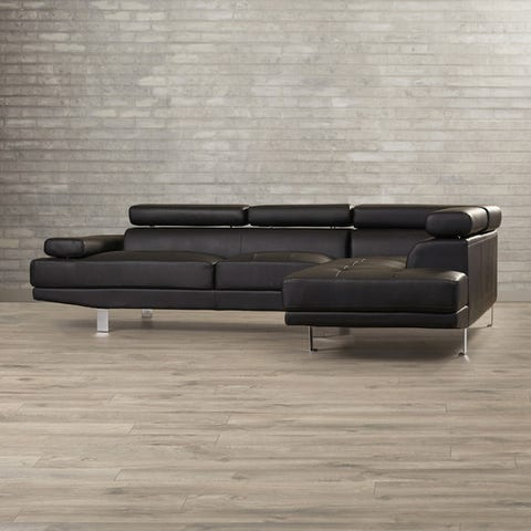 """<p><strong><em>$925, </em></strong><strong><em><a href=""""https://www.allmodern.com/Agosto-Right-Hand-Facing-Sectional-BRSD3377-BRSD3377.html"""" target=""""_blank"""">allmodern.com</a></em><a href=""""https://www.allmodern.com/Agosto-Right-Hand-Facing-Sectional-BRSD3377-BRSD3377.html"""" target=""""_blank""""></a></strong><a href=""""https://www.allmodern.com/Agosto-Right-Hand-Facing-Sectional-BRSD3377-BRSD3377.html"""" target=""""_blank""""></a> </p><p>For the bargain shopper with an eye for design, this firm-cushioned sectional showcases a distinctive, modernist shape in an easy-to-clean faux leather material. </p><p><strong>More: </strong><a href=""""http://www.bestproducts.com/home/decor/g31/chaise-lounge-sofas/"""" target=""""_blank"""">10 Best Chaise Sofas for Serious Lounging</a><br></p>"""