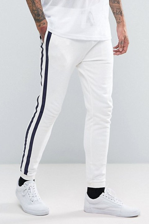 "<p><strong data-redactor-tag=""strong"" data-verified=""redactor""><em data-redactor-tag=""em"" data-verified=""redactor"">$40</em></strong> <a href=""http://us.asos.com/asos/asos-skinny-joggers-with-taping-in-white/prd/7790439?iid=7790439&amp;clr=White&amp;SearchQuery=&amp;cid=14274&amp;pgesize=204&amp;pge=0&amp;totalstyles=413&amp;gridsize=3&amp;gridrow=15&amp;gridcolumn=2"" target=""_blank"" class=""slide-buy--button"" data-tracking-id=""recirc-text-link"">BUY NOW</a></p><p>To keep your street style on the right track, try out ASOS' tapered white track bottoms for a lean&nbsp;look. These skinny white joggers have the comfort and stretch of a track bottom, but keep your look tight and fresh with a tailored fit. They pair perfectly with an oversized jacket or hoodie for a cool outfit proportion play.</p><p><strong data-redactor-tag=""strong"" data-verified=""redactor"">More:&nbsp;</strong><a href=""http://www.bestproducts.com/mens-style/g1402/jackets-for-men/"" target=""_blank"" data-tracking-id=""recirc-text-link"">Find the Right Men's Jacket to Beat the Heat in Style</a><span class=""redactor-invisible-space"" data-verified=""redactor"" data-redactor-tag=""span"" data-redactor-class=""redactor-invisible-space""><a href=""http://www.bestproducts.com/mens-style/g1402/jackets-for-men/""></a></span></p>"
