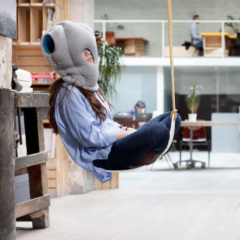 """<p><strong data-redactor-tag=""""strong"""" data-verified=""""redactor""""><em data-redactor-tag=""""em"""" data-verified=""""redactor"""">$99</em></strong> <a href=""""https://www.amazon.com/OSTRICH-PILLOW-ORIGINAL-Airplanes-Accessories/dp/B00B4S6SLW?tag=bp_links-20"""" target=""""_blank"""" class=""""slide-buy--button"""" data-tracking-id=""""recirc-text-link"""">BUY NOW</a></p><p>This pillow is perfect for when you need to take a nap after dinner but don't want to be *rude* by excusing yourself.&nbsp;</p>"""