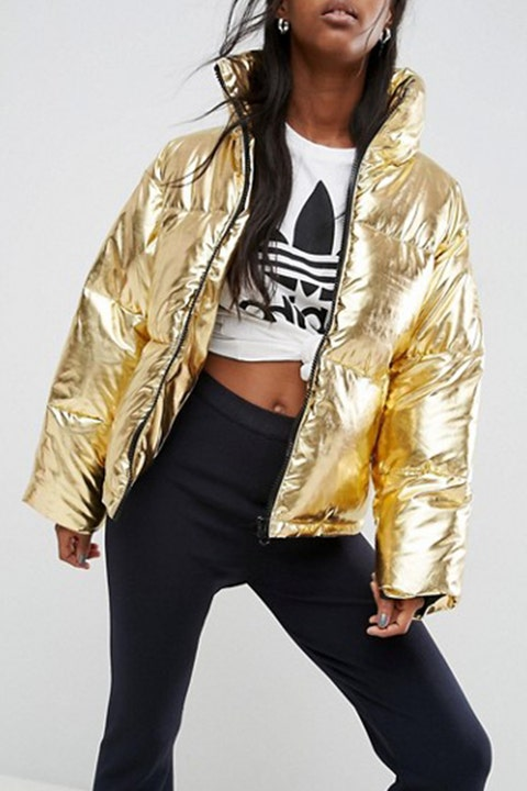 """<p><strong data-redactor-tag=""""strong"""" data-verified=""""redactor""""><em data-redactor-tag=""""em"""" data-verified=""""redactor"""">$95</em></strong> <a href=""""http://us.asos.com/asos/asos-metallic-puffer-jacket/prd/7975285?"""" target=""""_blank"""" class=""""slide-buy--button"""" data-tracking-id=""""recirc-text-link"""">BUY NOW</a></p><p>A gold puffer coat adds a luxe touch&nbsp;to your winter wardrobe. Wear with any and all things athleisure for a streetwear edge, or keep it classic as the accent piece to a basic denim-and-sweater combo.&nbsp;<span>This machine-washable jacket has a funnel neck that'll provide some serious warmth against wind and cold.&nbsp;</span></p><p><strong data-redactor-tag=""""strong"""" data-verified=""""redactor"""">More:</strong> <a href=""""http://www.bestproducts.com/fashion/g46/varisty-and-bomber-jackets/"""" target=""""_blank"""" data-tracking-id=""""recirc-text-link"""">Shop Our Picks for the Most Stylish Bomber Jackets Around</a></p>"""
