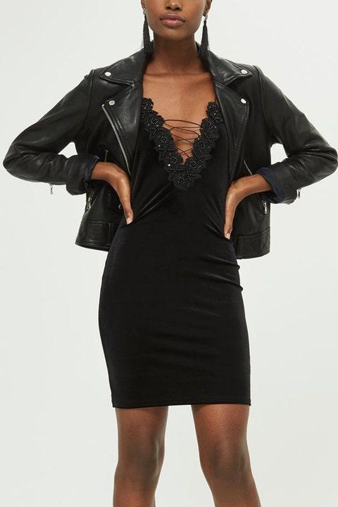 Clothing, Black, Fashion model, Dress, Little black dress, Shoulder, Fashion, Leather, Sleeve, Jacket,