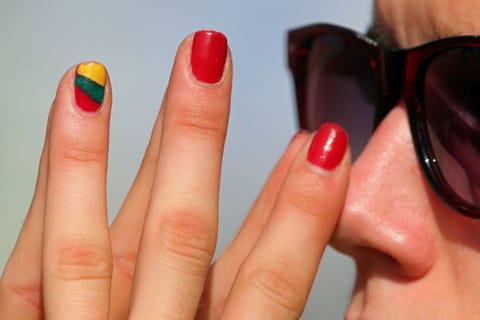 Eyewear, Glasses, Vision care, Finger, Lip, Blue, Skin, Red, Nail, Orange,