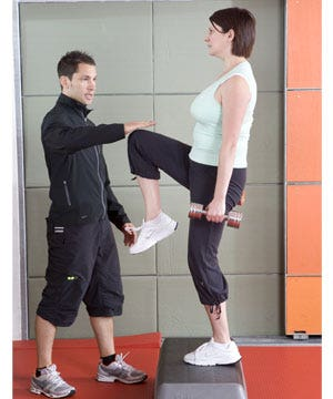 Start with feet shoulder-width apart, chest and head up. holding two weights, step up with your left leg, planting your whole foot onto the step. then push up, raising your right foot to the floor and step down with your left leg, before switching legs and starting again.<br />