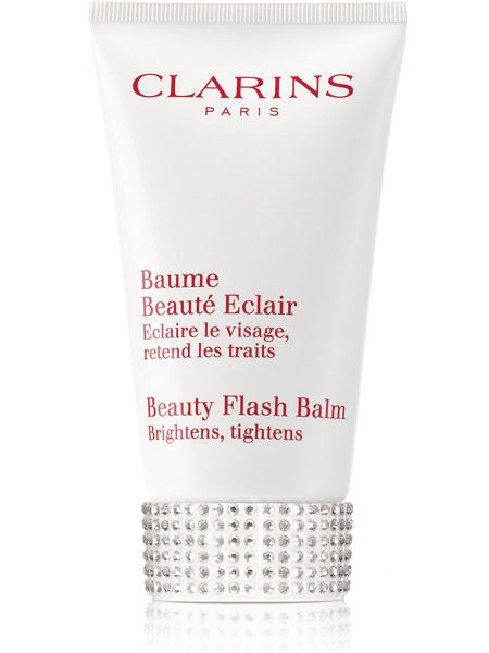 """<p>Before applying your face, douse it in Clarins' iconic Beauty Flash Balm. It brightens, tightens and acts as the perfect primer to ensure your makeup stays fresher for longer. We love the new Swarovski crystal adorned tube which means it will liven up your boudoir as well as your face!</p>  <p>Clarins Beauty Flash Balm, £26.50, <a target=""""_blank"""" href=""""http://uk.clarins.com/webapp/wcs/stores/servlet/beauty-products_day-creams_limited-edition-beauty-flash-balm_C010405099_10201_11751_-11_95501__"""">clarins.com</a></p>"""