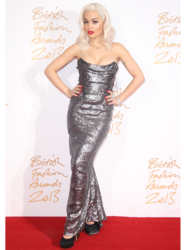 """<p>Woah, Rita! We're certainly in Ora of her glam get-up. Wearing a sparkly Vivienne Westwood strapless gown with wavy platinum blonde locks and her trademark red lips, Rita gave us Old School Hollywood, with a dash of Jessica Rabbit.</p> <p><a href=""""http://www.cosmopolitan.co.uk/fashion/shopping/best-dressed-celebrities-29-november"""" target=""""_blank"""">SEE: BEST DRESSED CELEBS OF THE WEEK</a></p> <p><a href=""""http://www.cosmopolitan.co.uk/fashion/celebrity/how-to-wear-sheer-dress"""" target=""""_blank"""">CELEBRITY HOW-TO: SHEER DRESSES</a></p> <p><a href=""""http://www.cosmopolitan.co.uk/fashion/love/"""" target=""""_blank"""">RATE OR SLATE CELEBRITY STYLE</a></p>"""
