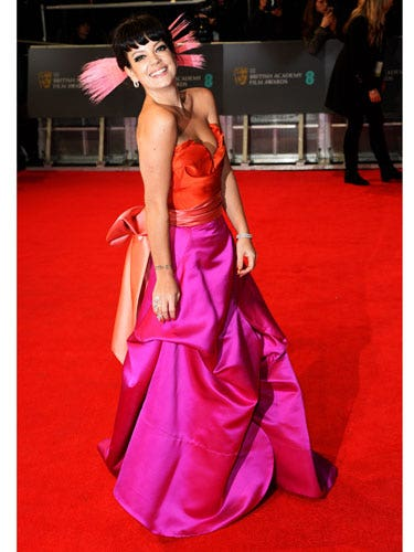 "<p>Looking at Lily Allen on red carpets is perhaps our most favourite thing - even more so than 'sitting down and having a cheese-based snack', which is quite the claim.</p> <p>Loving Lily's bold choice for the BAFTAs tonight. Not sure about the headpiece yet but give us half an hour and we'll be totally obsessed.</p> <p><a href=""cosmopolitan.co.uk/fashion/news/golden-globes-red-carpet-dresses?click=main_sr"" target=""_blank"">RED CARPET AT THE GOLDEN GLOBES 2014</a></p> <p><a href=""http://www.cosmopolitan.co.uk/beauty-hair/news/styles/celebrity/baftas-2013-best-red-carpet-hair-and-beauty?click=main_sr"" target=""_blank"">LOOK BACK AT THE BAFTAS RED CARPET FROM 2013</a></p> <p><a href=""http://www.cosmopolitan.co.uk/beauty-hair/news/trends/celebrity-beauty/behind-the-scenes-beauty-at-the-tv-baftas?click=main_sr"" target=""_blank"">BEHIND THE SCENES AT THE BAFTAS: HOW THE STARS GET RED CARPET READY</a></p>"