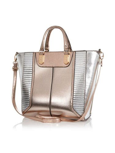 "<p>Add a sheen to your look - literally - with a metallic tote bag; big enough to cart around all your stuff and totally on trend, too.</p> <p>Metallic tote bag, £45, <a href=""http://www.riverisland.com/women/bags--purses/shopper--tote-bags/Rose-gold-metallic-colour-block-tote-bag-651309"" target=""_blank"">riverisland.com</a></p> <p><a href=""http://www.cosmopolitan.co.uk/fashion/shopping/spring-shoes-fashion-high-street"" target=""_blank"">STEP INTO NEW SEASON: 10 PAIRS OF SPRING-LIKE SHOES</a></p> <p><a href=""http://www.cosmopolitan.co.uk/fashion/shopping/handbags-spring-fashion-high-street"" target=""_blank"">NEW SEASON ARM CANDY: 12 HOT HANDBAGS</a></p> <p><a href=""http://www.cosmopolitan.co.uk/fashion/shopping/spring-fashion-trends-2014?page=1"" target=""_blank"">7 BIG FASHION TRENDS FOR SPRING 2014</a></p>"