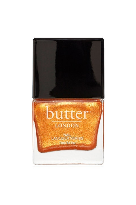 """Sunny getaways call for a color that's just <em>fun</em>. Your move, nudes.   <em>Butter Nail Lacquer in """"Chuffed,"""" $15; <a href=""""http://www.butterlondon.com/Lacquers/Orange-Nail-Lacquers/Chuffed-Nail-Lacquer.html"""" target=""""_blank"""">butterlondon.com</a></em>"""