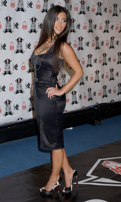Clothing, Dress, Shoulder, Footwear, Hairstyle, Leg, Little black dress, Fashion, Joint, Fashion model,