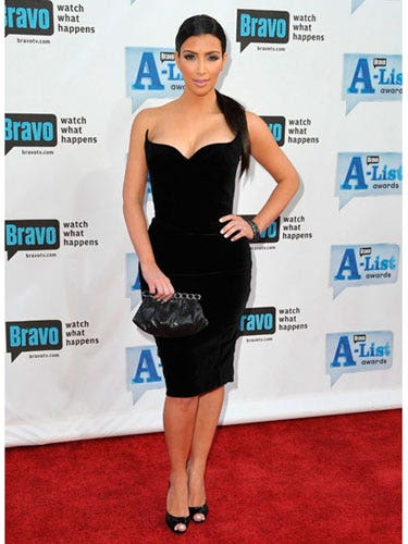 Even if you're <i>Keeping Up with the Kardashians,</i> it's damn hard look as hot as Kim. In a black LBD and open-toe pumps, she rocks the red carpet at Bravo's A-List Awards.