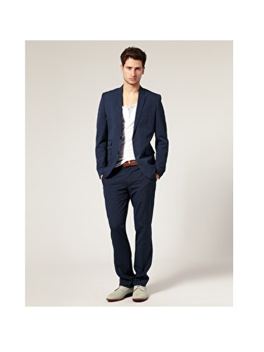 """Just like women have the little black dress, men have the navy blazer. A fitted single-breasted, <a href=""""http://www.askmen.com/fashion/fashiontip_400/440_two-button-or-three-button-suit.html"""" target=""""_blank"""">two-button blazer</a> with a notched lapel has the power to transform an otherwise ho-hum office-shirt-and-tie combo into something dapper.  <br /><br /> Bonus:  He'll be able to wear this with everything from jeans to, well, those office-shirt-and-tie combos.<br /><br /> ASOS Slim Fit Blue Suit Jacket, $118.17 <br /> <a href=""""http://us.asos.com/Baku-Hipster-Pant-With-Sliders/tfov0/?sgid=3078&cid=5678&Rf900=1494&Rf-200=3&sh=0&pge=0&pgesize=20&sort=-1&clr=Blue&mporgp=L0FTT1MtU2xpbS1GaXQtQmx1ZS1TdWl0LS8"""" target=""""_blank"""">asos.com</a>"""
