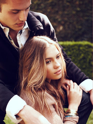 …He touches you a lot. Men who aren't comfortable with themselves can be too needy, and touching your arm, shoulders, and back a ton subconsciously signals that he's trying to grab onto you. These guys often look down a lot, too.