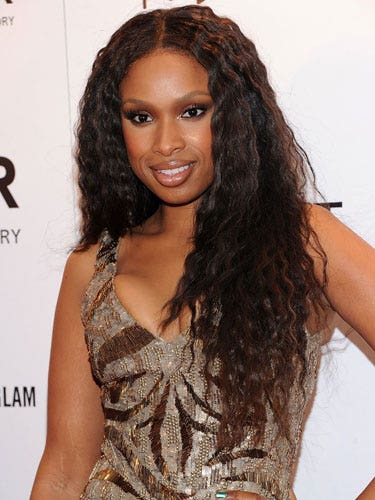 Crimping is one of the easiest things you can do with a flat iron—and the effect is subtle, not dated. To understand how to do it, hold your flat iron in front of you and twist your wrist from side to side—that's the same motion you'll do in your hair. Starting with straight locks, grab a one-inch section of hair, position your flat iron at the root, and twist your wrist back and forth as you glide the iron all the way down. Repeat throughout.