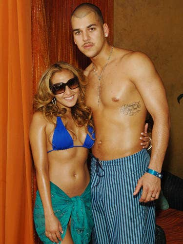 Rob Kardashian had then-girlfriend Adrienne Bailon's name tattooed onto his rib cage; she got his name tatted onto her butt. After they split, she had hers removed. No word on Rob's plans.