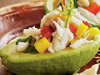 <p>1 lime, zest finely grated, lime cut in 1/2<br />2 tablespoons olive oil<br />2 tablespoons chopped cilantro leaves<br />1/2 mango, peeled and cut into 1/4-inch dice (about 1 cup)<br />1/3 cup diced (1/4-inch) red bell peppers<br />1/3 cup diced (1/4-inch) red onion<br />1/2 jalapeno, stemmed and cut into small dice (about 2 tablespoons)<br />1/2 pound jumbo lump crabmeat<br />3 Hass avocados<br /><br />Squeeze the juice from 1 half of the lime into a bowl. Add the olive oil and cilantro and whisk well. Add the mango, red pepper, onion, jalapeno, and lime zest and toss to coat. Gently stir in the crabmeat to keep it from breaking up. Set aside while preparing the avocados. Cut the avocados in half and remove pit. Squeeze the remaining lime half over the avocado flesh, using the lime half to spread it evenly, in order to keep them from turning black.</p> <p>Toss the crab salad, check for seasoning, and mound into the avocado halves, dividing it evenly. (Use an ice cream scoop for neat, even rounds.) Serve right away.</p> <p>TIP: To keep the avocado from sliding around the plate, cut a thin sliver of skin from the rounded side before filling the avocados. That flat portion will help keep the avocado steady on the plate.</p> <p> </p>