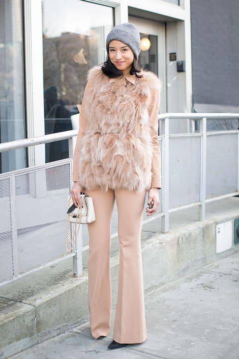 Clothing, Shoulder, Textile, Street fashion, Fashion model, Winter, Fashion, Fur clothing, Natural material, Fur,