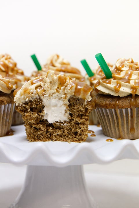 """One of Starbucks most popular drinks in edible form. Coffee cake, coffee whipped cream filling, topped with a coffee vanilla butter cream drizzled with caramel. Can you say delish?  <strong>Get the recipe from <a href=""""http://natventures.tumblr.com/post/18062563920/starbucks-cupcakes"""">Sweets</a>.</strong>"""