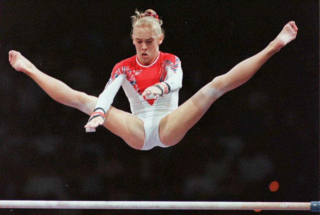 Finger, Human leg, Sportswear, Sports uniform, Joint, Jumping, Elbow, Wrist, Knee, Athlete,