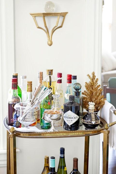 Glass bottle, Bottle, Alcohol, Alcoholic beverage, Drink, Distilled beverage, Barware, Drinkware, Bottle cap, Light fixture,