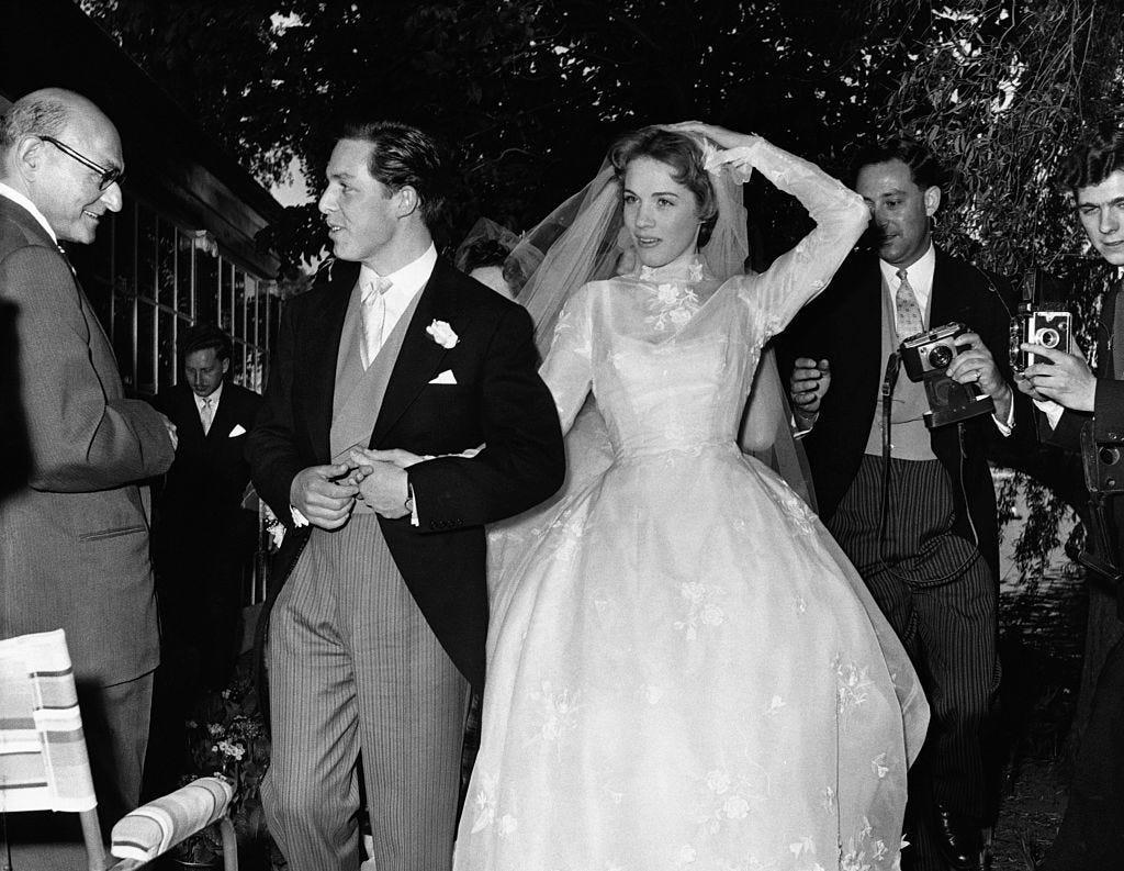 Coat, Trousers, Event, Bridal clothing, Dress, Suit, Photograph, Outerwear, Bridal veil, Formal wear,
