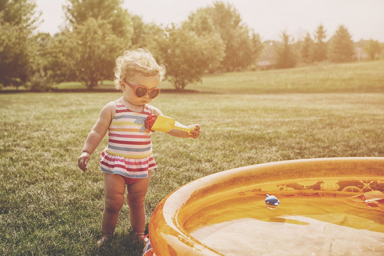 People in nature, Photograph, Child, Yellow, Water, Play, Toddler, Fun, Grass, Sunlight,