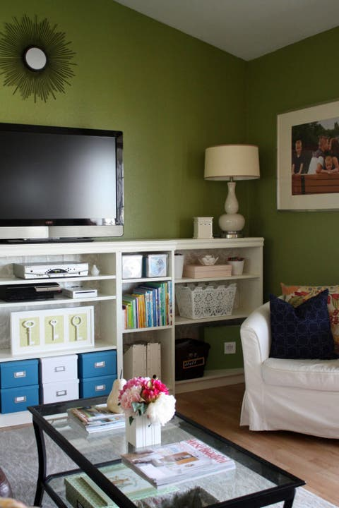 Room, Interior design, Green, Living room, Furniture, Wall, Home, Table, Display device, Interior design,
