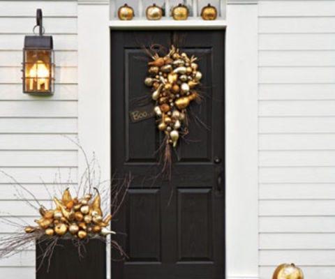 gilded pumpkins on doorstep