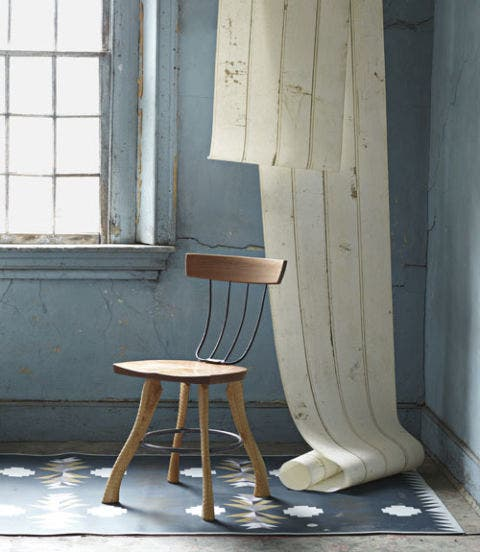wood chair in room with blue walls