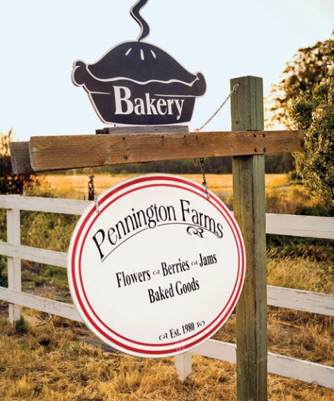 pennington farms painted wooden sign with pie on top