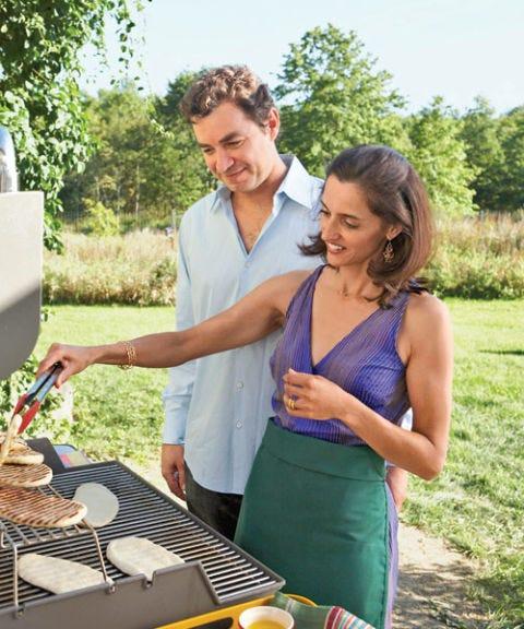 man and woman at grill