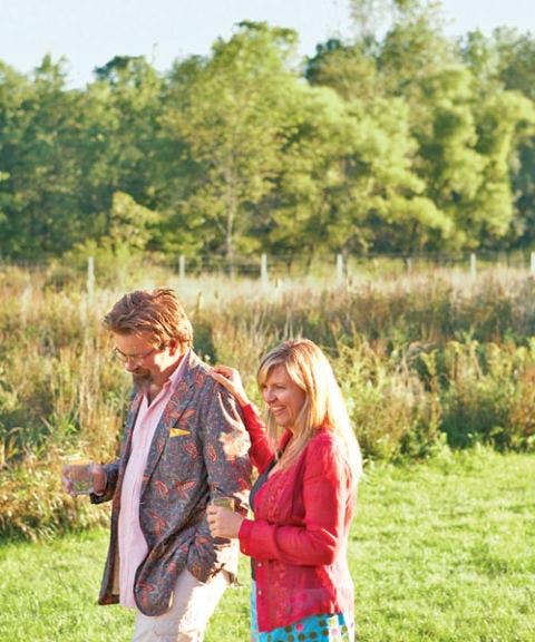 two people walking in a field