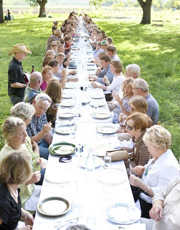 people gathered to share a meal made from entirely local produce