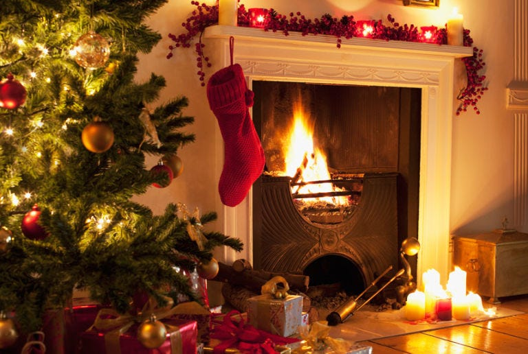 Christmas, Hearth, Fireplace, Christmas decoration, Christmas stocking, Christmas eve, Tree, Christmas tree, Tradition, Lighting,
