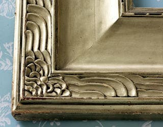 detail of metallic carved picture frame