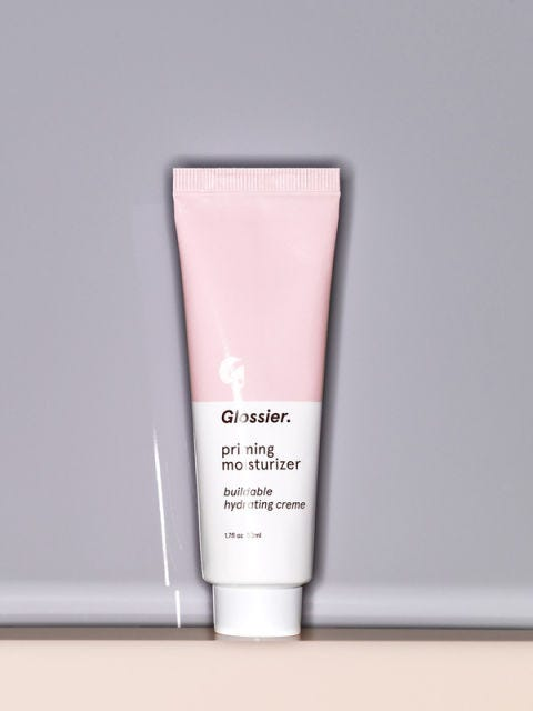 """Dewy skin has been the look du jour for the past few seasons, and we think&nbsp;the <em>second</em> best way to get that&nbsp;glow&nbsp;is with a little of this&nbsp;Glossier goodness. Apply it to your face&nbsp;before your makeup and it will plump up your skin, minimize your pores, and give you that after-sex radiance.  $25; <a href=""""https://www.glossier.com/#!/products/priming-moisturizer?utm_source=ITGPrimingMoisturizer300x600"""">glossier.com</a>"""