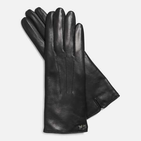 "Coach Leather Tech Glove, $74;<a href=""http://www.coach.com/online/handbags/Product-coach-10551-10051-85125-en?cs=blk&amp;storeId=10551&amp;catalogId=10051&amp;langId=-1&amp;partNumber=85125_blk&amp;Cid=A_L1&amp;siteID=Hy3bqNL2jtQ-1RlDtpfiGMIcV1cPXiHWwQ""> coach.com</a>  <!--EndFragment-->"