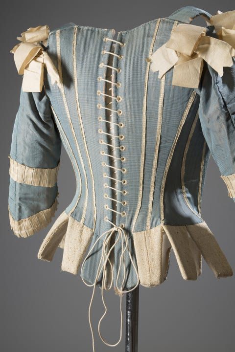 """Stays—otherwise known as whalebone corsets—were everyday wardrobe staples for """"proper"""" women of the eighteenth century. Yes, these undergarments don't look like the sexy bustier-corsets of today, but they were essential in molding&nbsp;the ideal body form: a tiny waist and pushed-up breasts. As Colleen Hill notes&nbsp;in <em><a href=""""http://www.amazon.com/Exposed-History-Lingerie-Colleen-Hill/dp/0300208863"""">Exposed: A History of Lingerie</a></em>, the French ceremonial ritual of the <em>toilette</em>, a morning routine of&nbsp;undressing and dressing in front of the court, involved putting on a stay. Women performing the <em>toilette</em> would linger on the undergarments, hinting at the sexual intimacy and voyeurism involved.  <em>Corset (Stays)/Silk, Silk Ribbon, Whalebone, ca.1770, Possibly Europe</em>  <!--EndFragment-->   <!--EndFragment-->"""