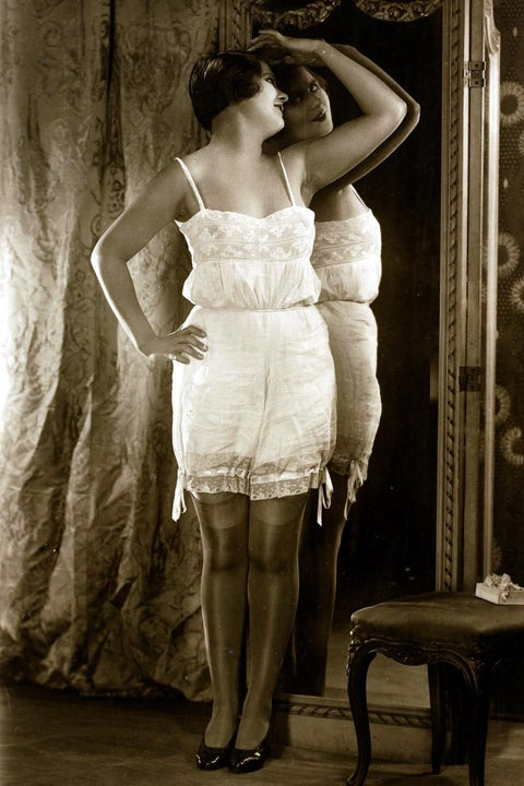 Erotic Postcards, Circa 1915, Dishabille, Dark haired woman wearing an undergarment standing by a mirror  (Photo by Bob Thomas/Popperfoto/Getty Images)