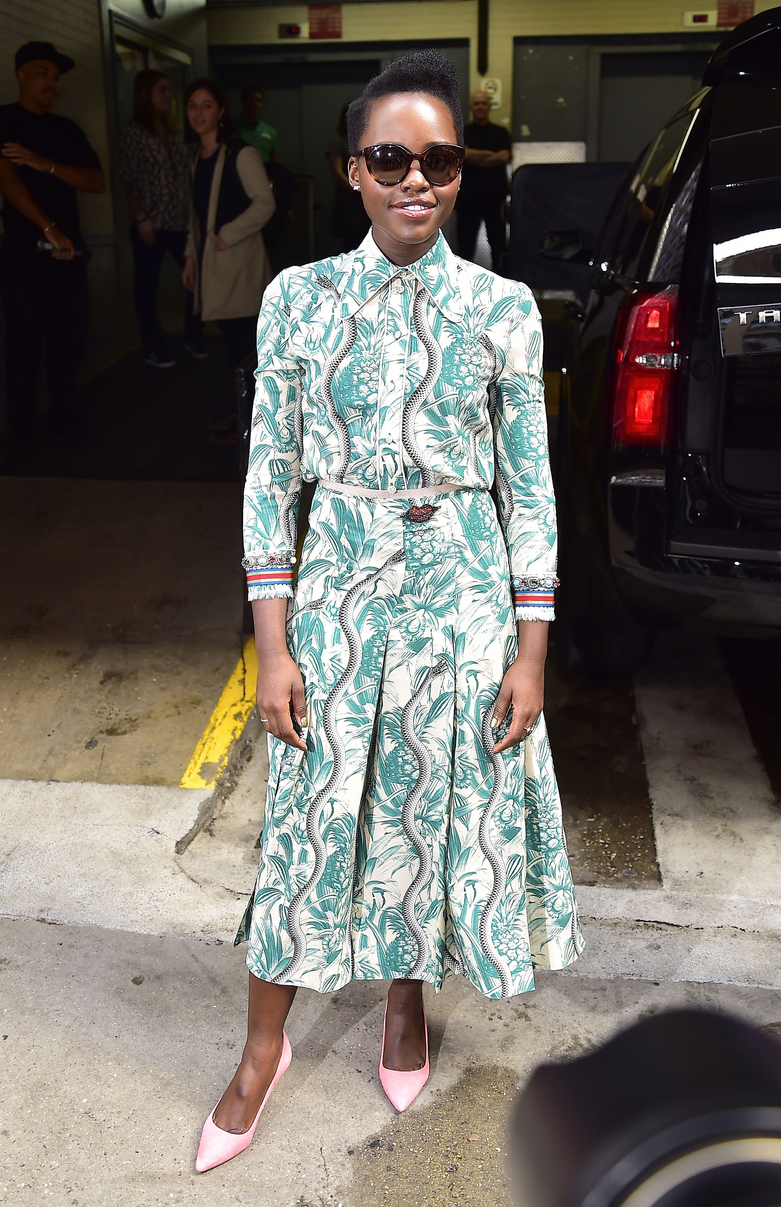 <p>Who: Lupita Nyong'o</p><p>When: March 10, 2016</p><p>Why: There's a lot going on with this palm tree and snake print shirtdress from Gucci's spring 2016 collection, but Lupita Nyong'o has a knack for wearing bold statements. She takes it one step further by accessorizing with bubblegum pink stilettos. </p>