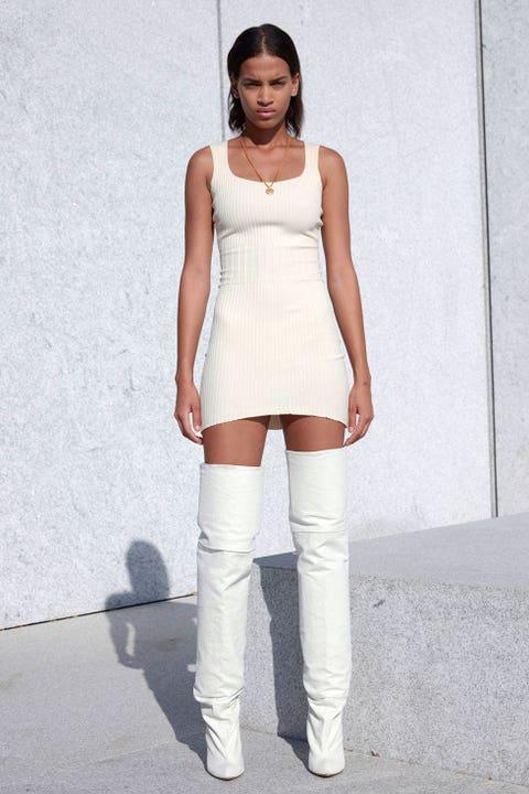 Clothing, Sleeve, Shoulder, Joint, White, Knee, Street fashion, Waist, Sleeveless shirt, Boot,