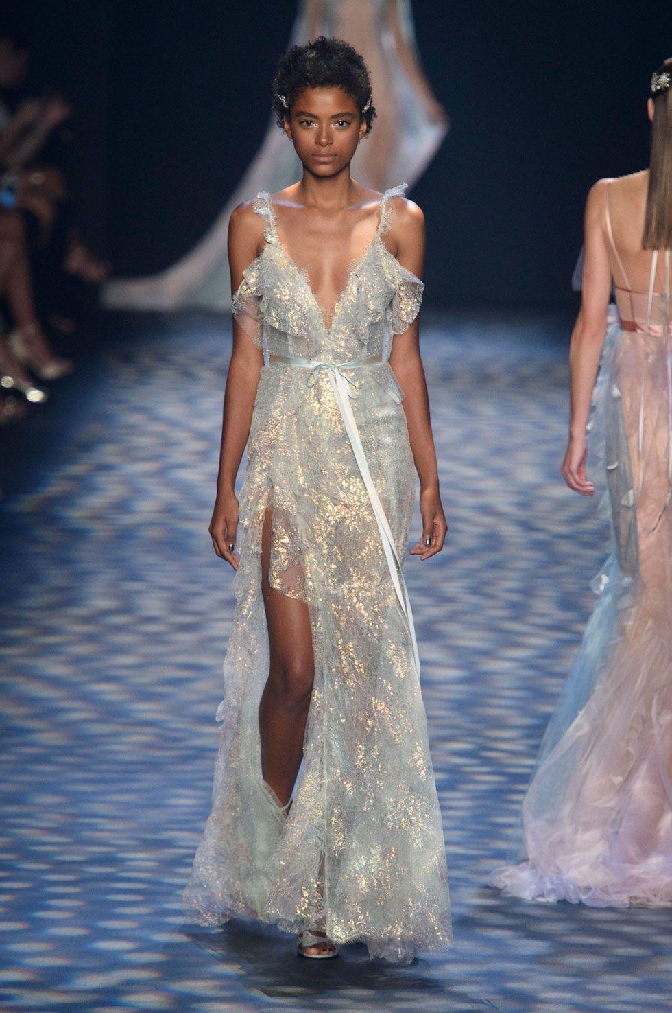 Fashion show, Hairstyle, Dress, Shoulder, Runway, Waist, Gown, Formal wear, Style, One-piece garment,