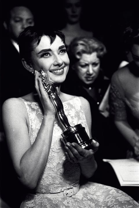 """<p>Hepburn may have won Best Actress for her role in the film <i data-redactor-tag=""""i"""">Roman Holiday</i>, but we can't help but think that the flashbulbs went off to capture her iconic thick brows that were flawlessly framed by her piece-y short bangs.</p>"""