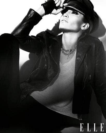 Mouth, Jewellery, Sleeve, Jacket, Audio equipment, Style, Black hair, Fashion accessory, Fashion, Leather,