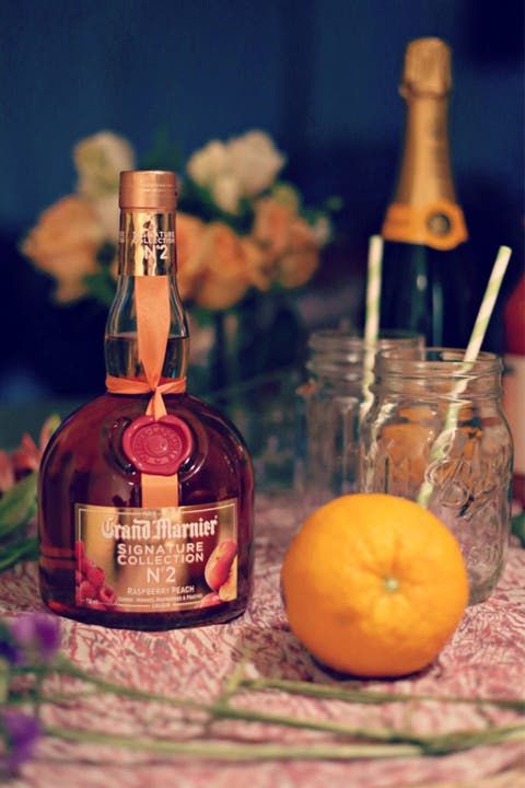 Glass bottle, Bottle, Alcohol, Alcoholic beverage, Distilled beverage, Drink, Barware, Produce, Fruit, Liquid,