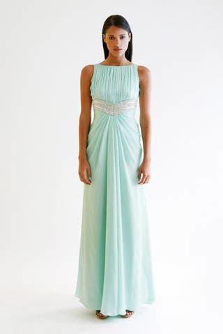 Blue, Sleeve, Dress, Shoulder, Textile, Standing, Joint, One-piece garment, Formal wear, Gown,