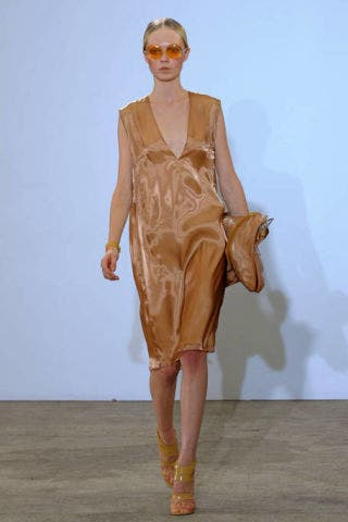 Brown, Human body, Shoulder, Textile, Joint, Fashion show, Dress, Style, Fashion accessory, Runway,