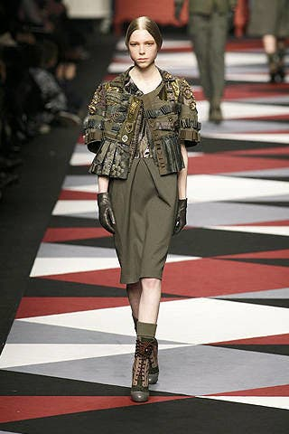 Human, Fashion show, Shoulder, Joint, Outerwear, Runway, Fashion model, Style, Street fashion, Dress,