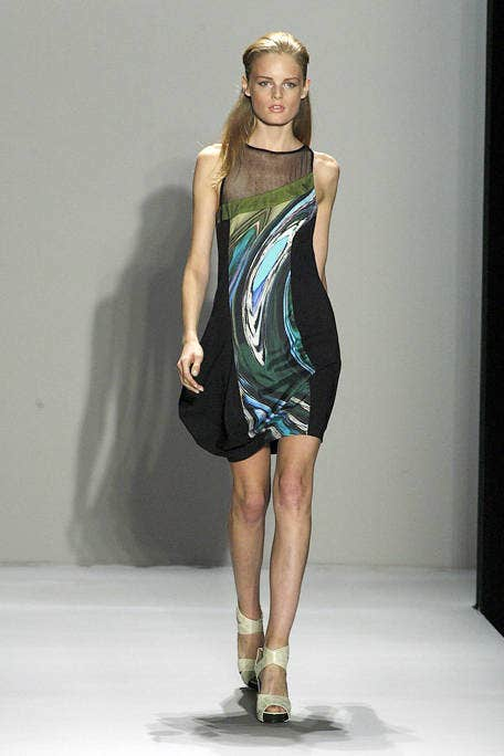 Clothing, Human body, Dress, Human leg, Shoulder, Fashion show, Joint, One-piece garment, Style, Fashion model,