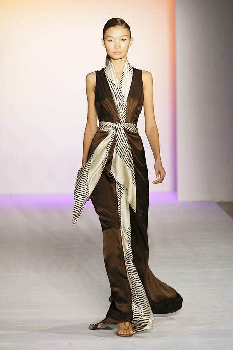 Shoulder, Joint, Fashion show, Runway, Style, Formal wear, Fashion model, Waist, Fashion, Neck,